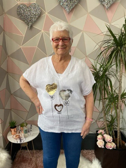 White balloon heart top, fitting up to a size 16