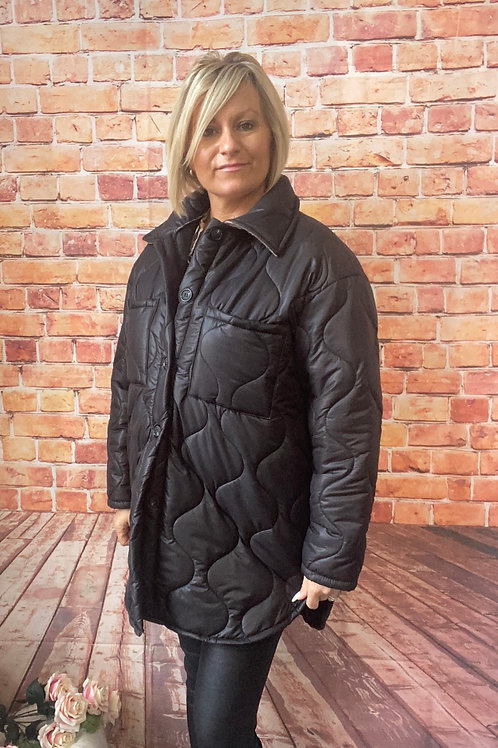 Black quilted coat. Fitting up to a size 18