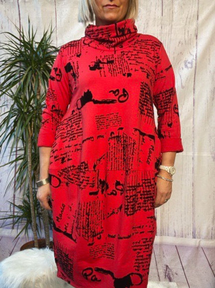 Red monet tunic, fitting up to a size 16.   6565