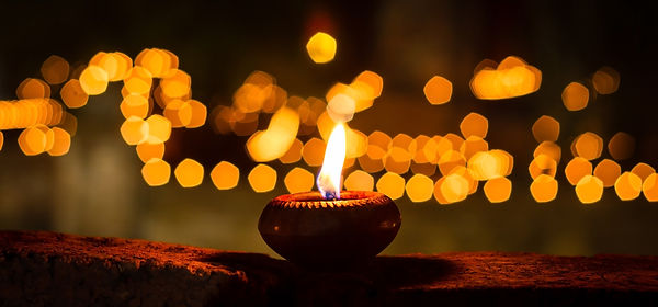 One candle flame at night closeup.jpg