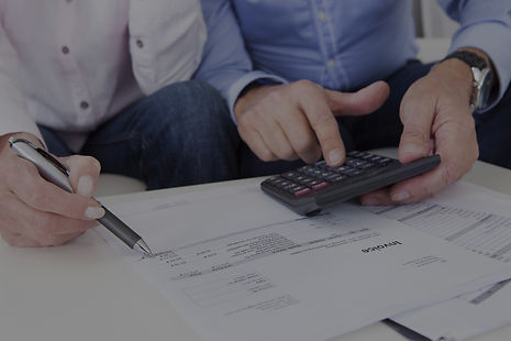 two people looking over finances with a calculator