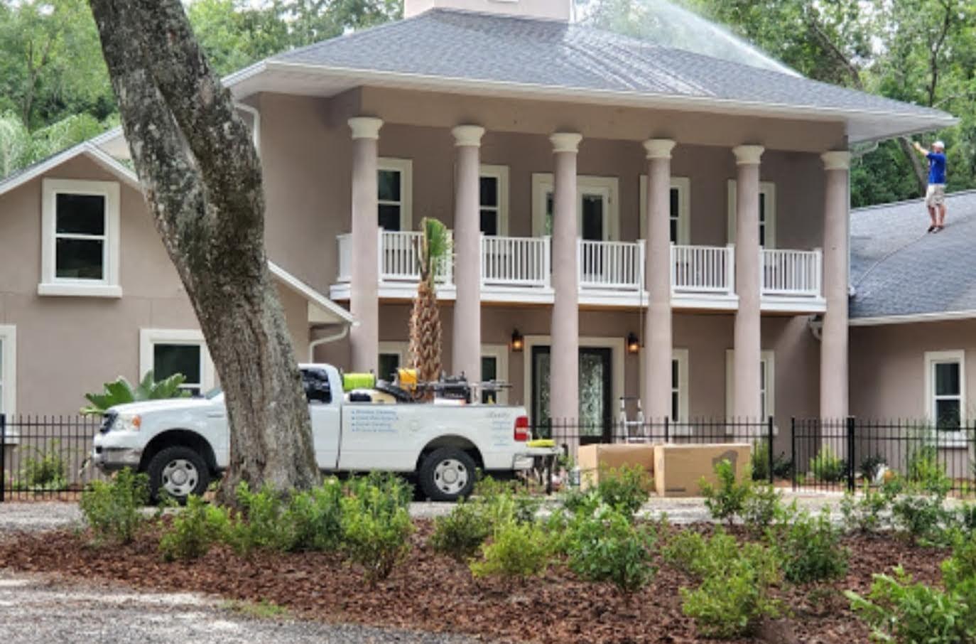 Softwashing a 3 story home in Fernandina Beach Florida