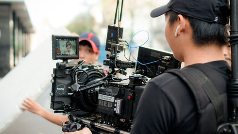 photo-of-person-holding-camera-equipment
