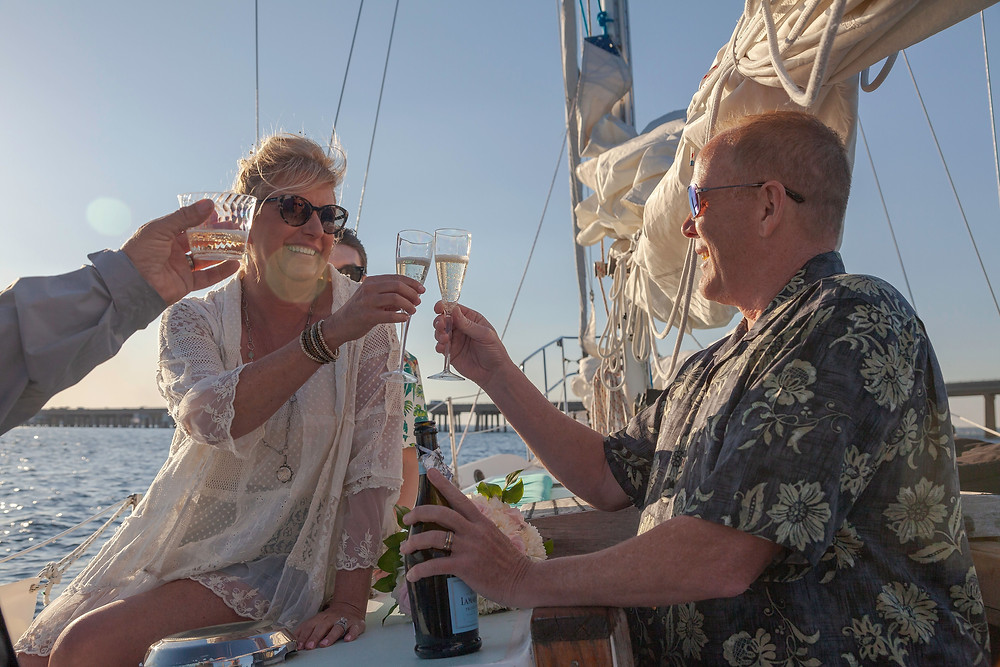 A champagne toast to the new couple after having their wedding ceremony . Destin, Florida