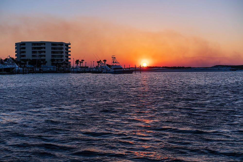 The sun sets over the Destin Harbor. Destin, Florida.