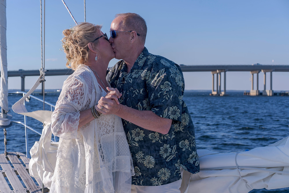 First kiss as a married couple aboard Selah in Destin, Florida