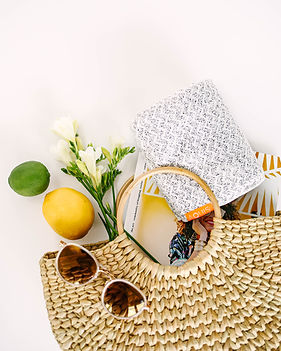 Basket of various lifestyle, hospitality, media, and social impact items