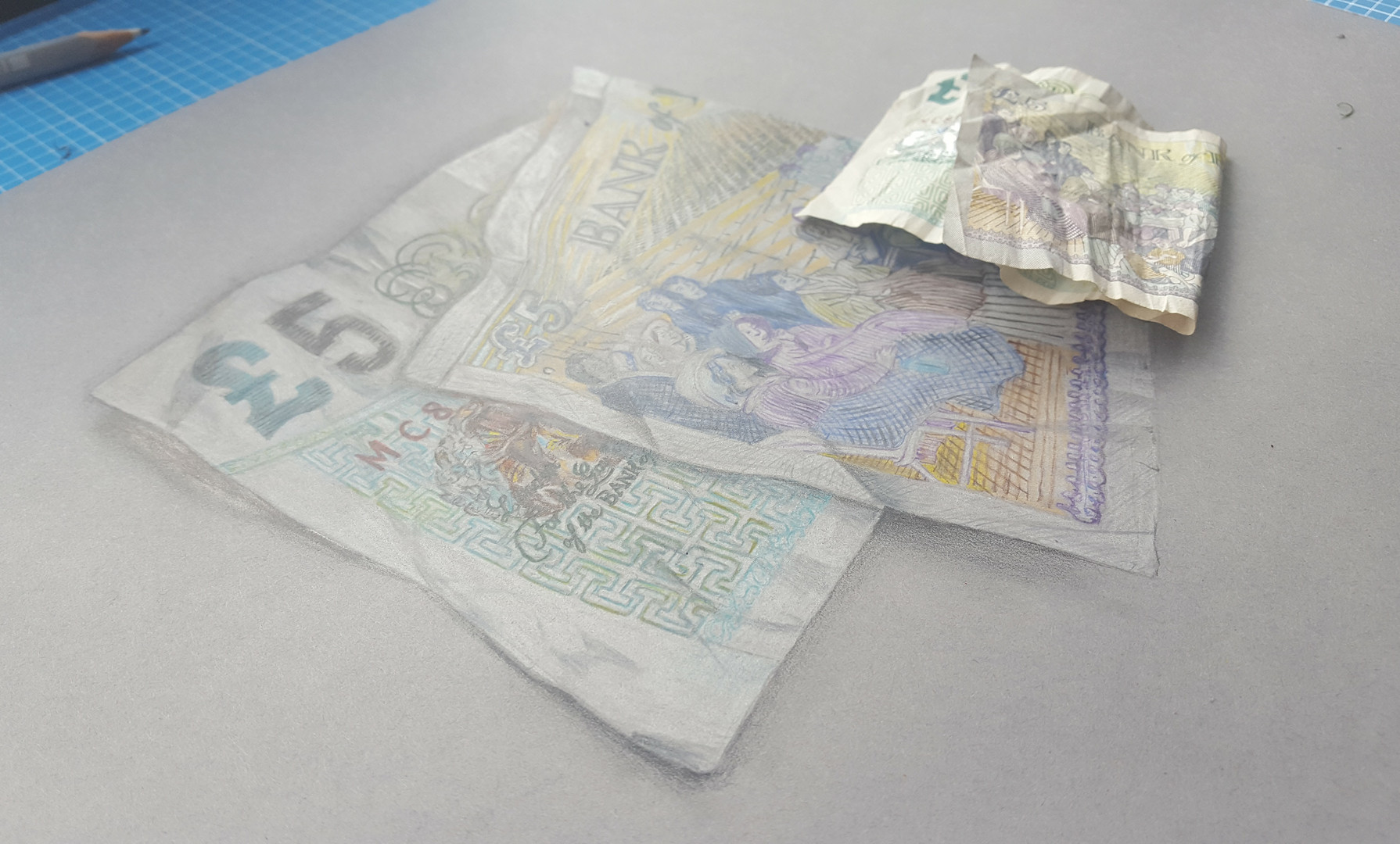 Finished drawing next to the same £5 note.
