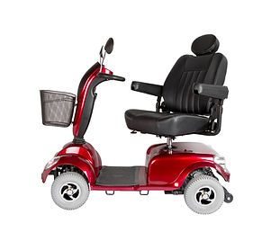 Side view of a red, four wheel electric scooter with shopping basket and adjustable seat.jpg