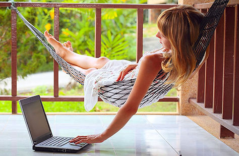 woman_working_remotely_in_hammock_-_dd.j