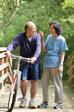 Imageof older Asian couple looking happy to be on a walk together