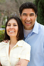 ethnic couple smiling