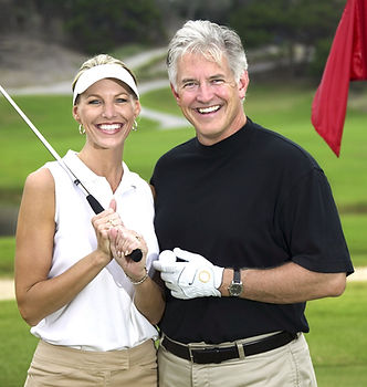 Image of a caucasian couple golfing, symbolizing togetherness after relationship coaching