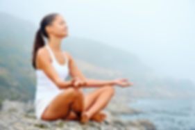Image of young woman meditating, symbolizing spiritual coaching, Tacoma