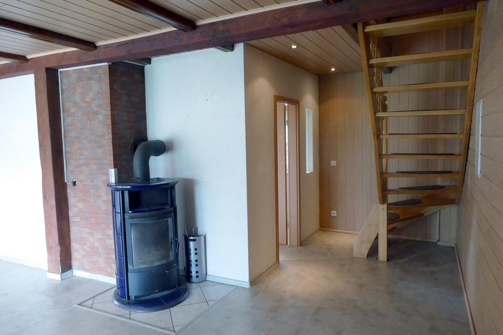 Wohnzimmer mit Kamin Scheune