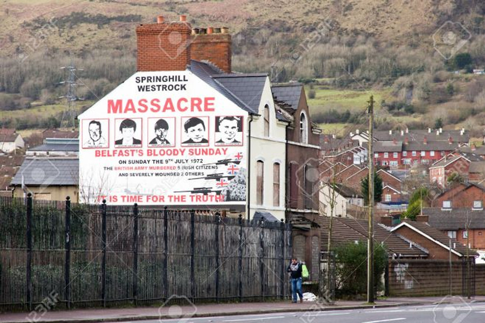 BELFAST, NORTHERN IRELAND - FEB 9, 2014: Mural of Springhill westrock massacre on Springfield Road in Belfast, Northern Ireland. Springfield Road was the site of much activity during the Troubles.