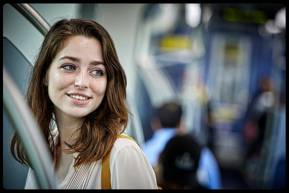 Young woman on public transit.
