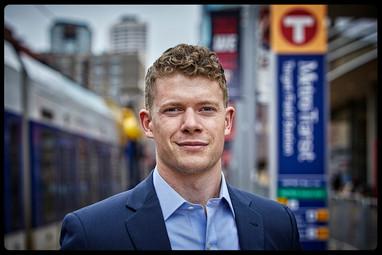 Business man taken at a transit stop in Minneapolis, MN.