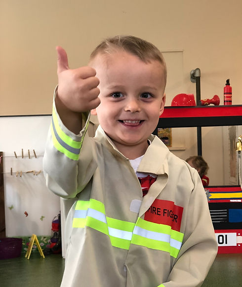 Child in fireman suit