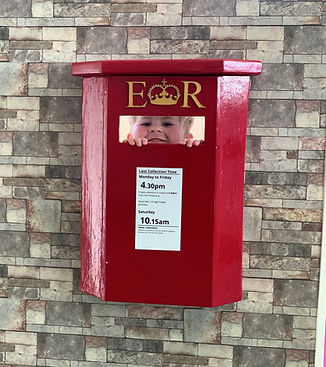 Child looking through postbox