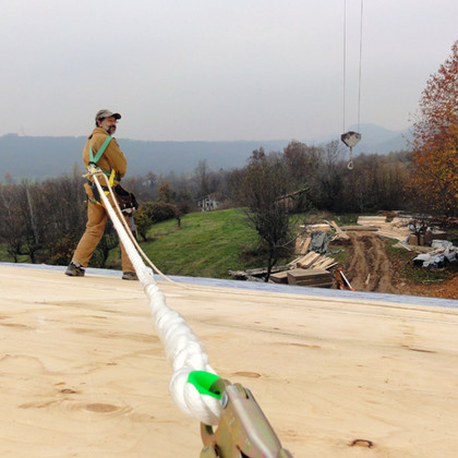 """Laying the roof on the """"Casa Clima"""" in Italy."""