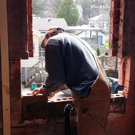Preparing a window opening with some masonry.