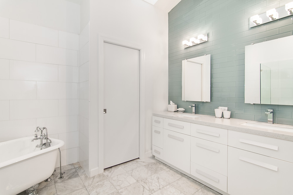 What a massive difference in this master bathroom design!