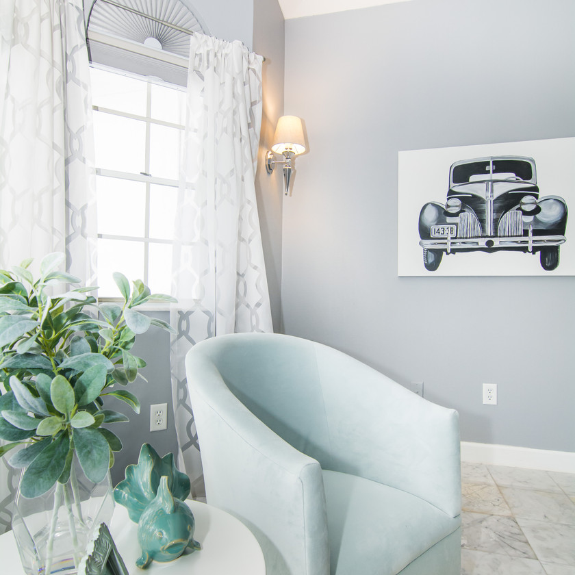Sitting room in master bedroom, aqua chairs, wall painting