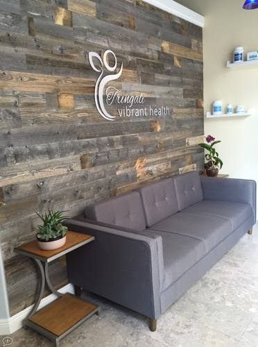 Reception with reclaimed wood wall design