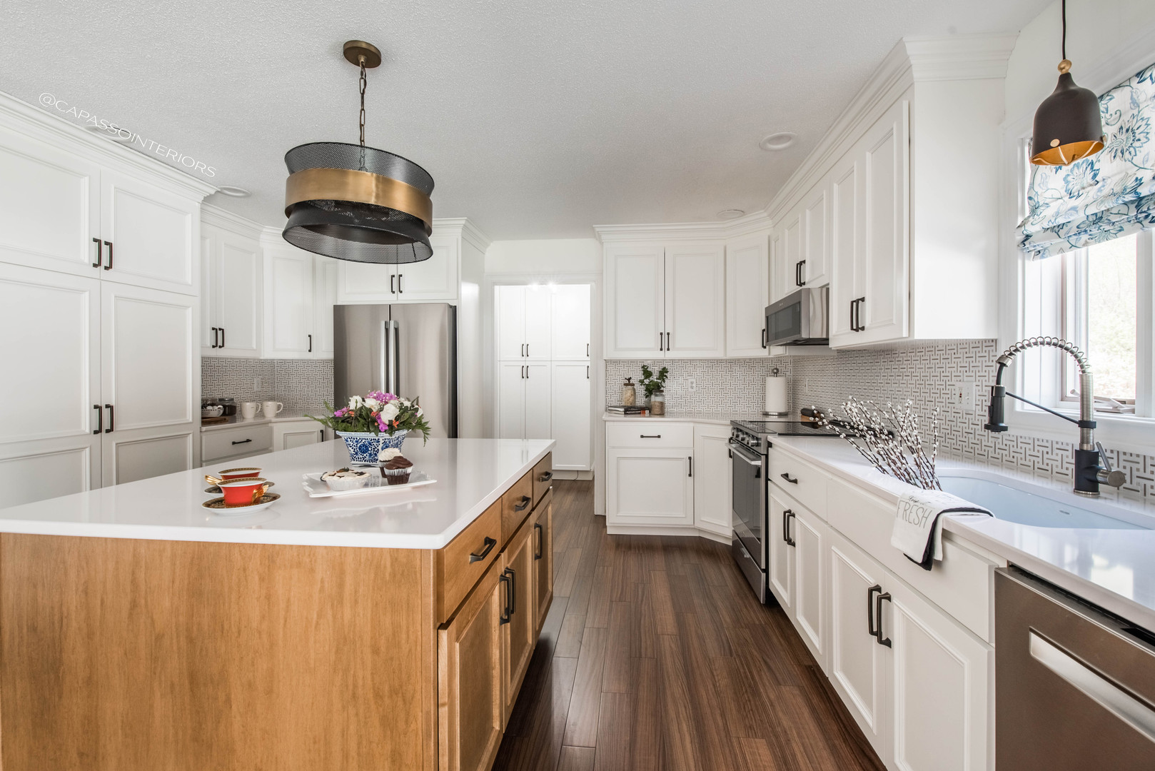 White kitchen with wood island