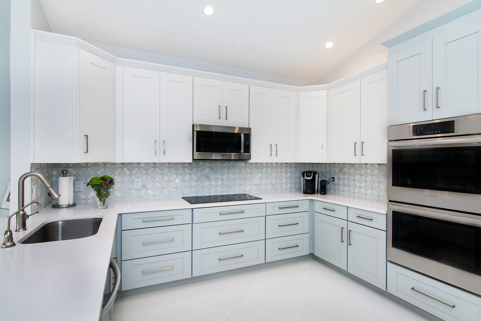 Modern and contemporary kitchen design with two tone cabinets, gray and white