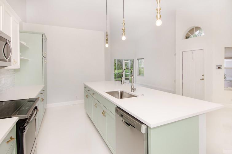 Mint green and white kitchen design