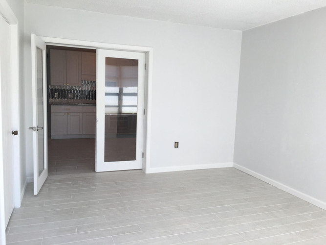 Den addition in this townhouse with a brand new french door!