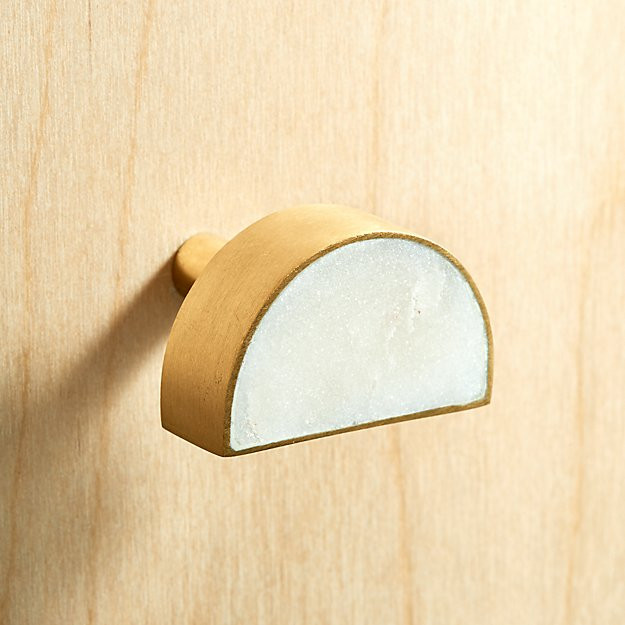 Half moon shape with gold accent. Turn it upside down, or sideways, or install them side to side and create a circle. So cool.