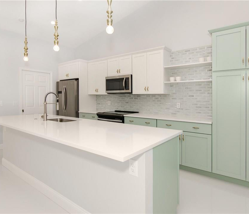 Mint green and white two tone kitchen, galley shape, large island, quartz