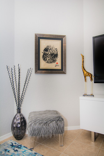 Wall decor with accessories and a stool