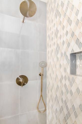 Stunning tile design in master bathroom shower