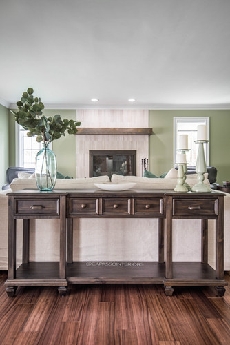 Sofa table with accessories and decorative items