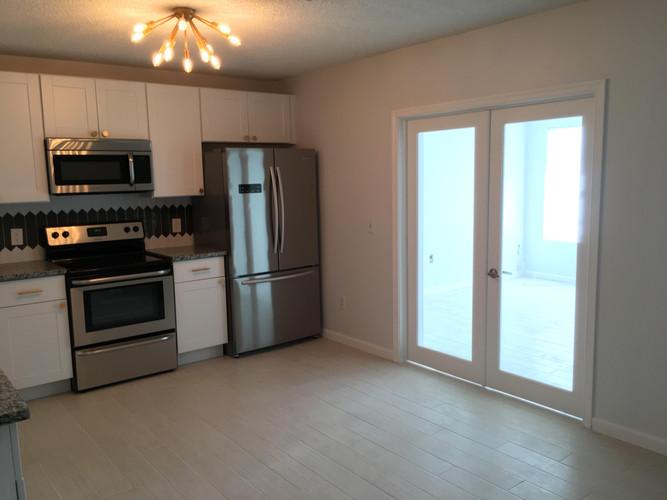 Kitchen with bonus room extension