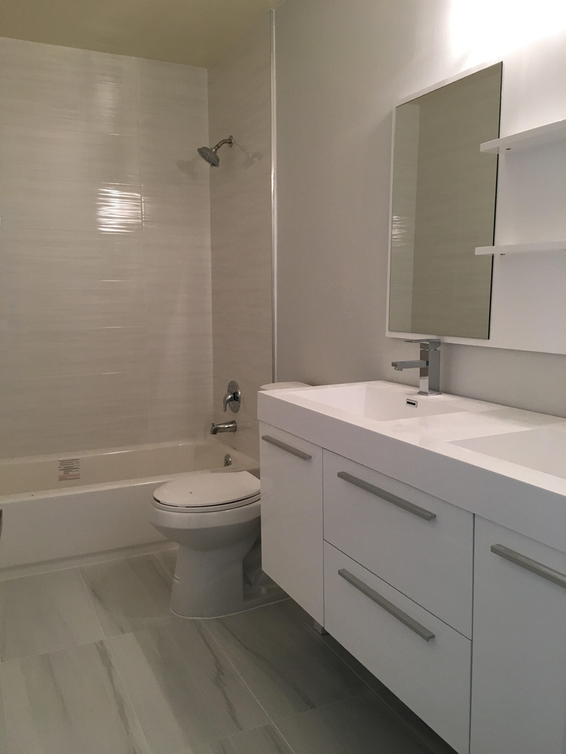 Guest bathroom remodel with grays and whites for a neutral feel