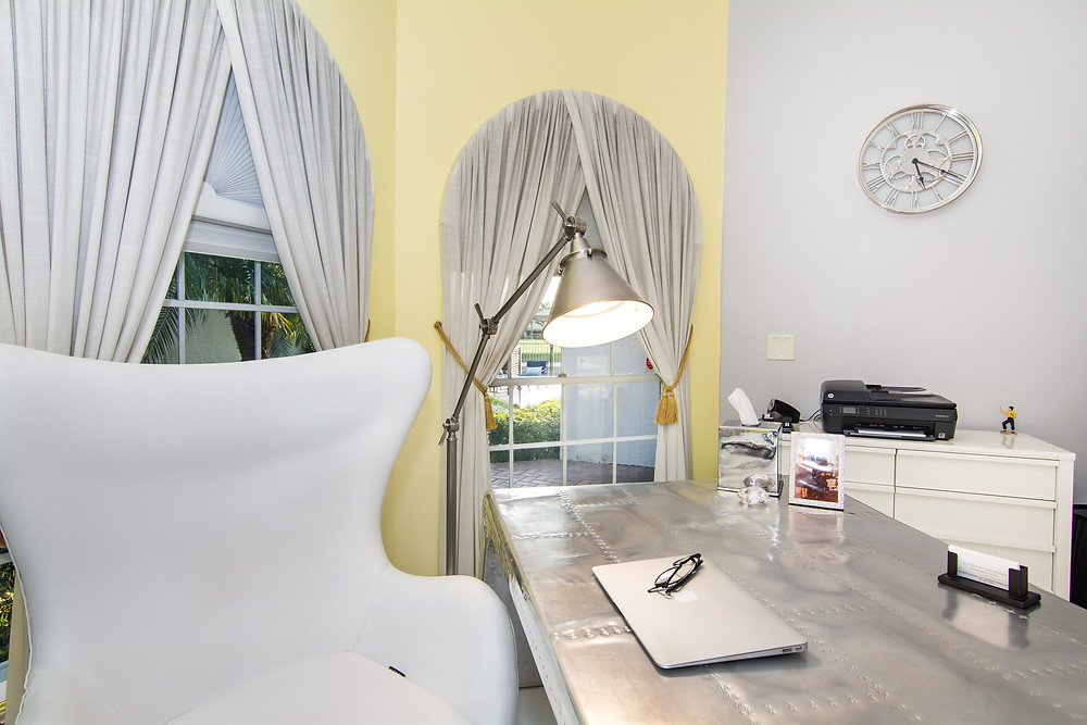 Home office interior with yellow and gray walls, airplane wing desk, modern design