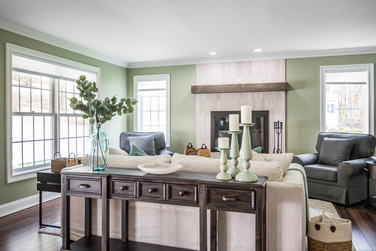 Family room with fireplace, console, and decor