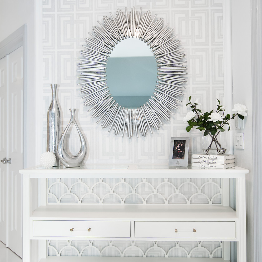 Glam entry with wall paper, mirror, console, decor and styling