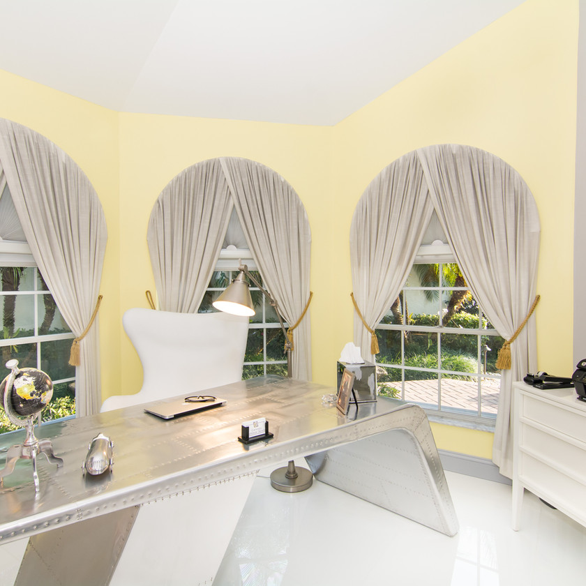 Home Office design, airplane wing aluminum desk, yellow and gray walls