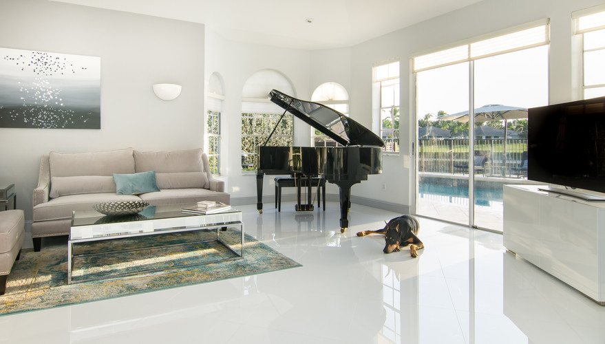 Open plan monochromatic interior design with a pop of teal