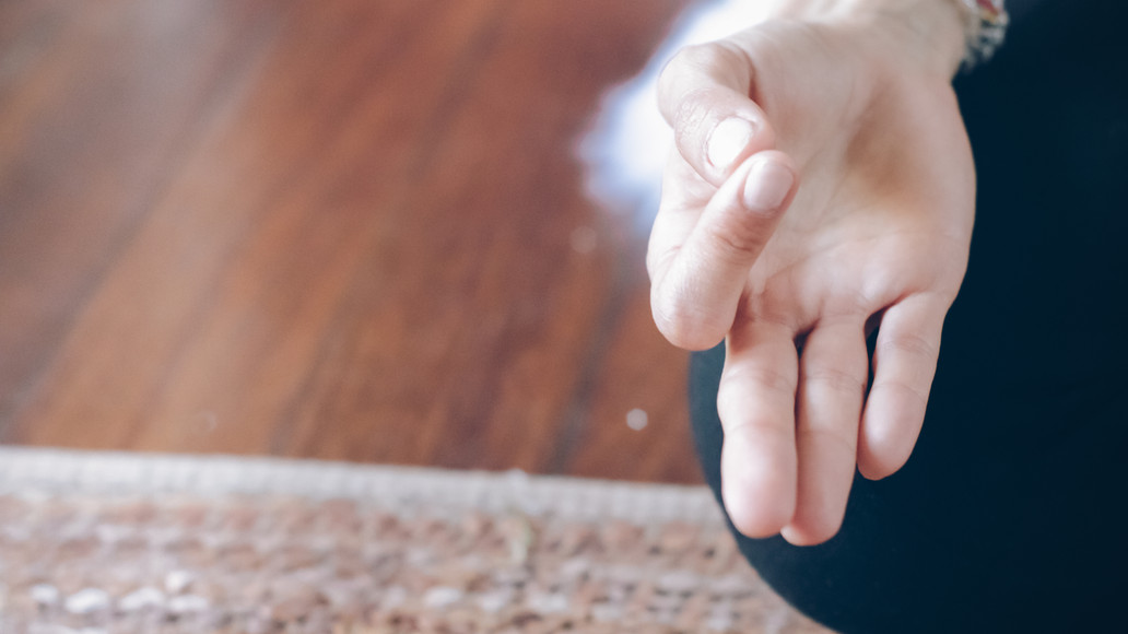 Ona Healing meditating