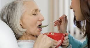 Person being fed with a spoon