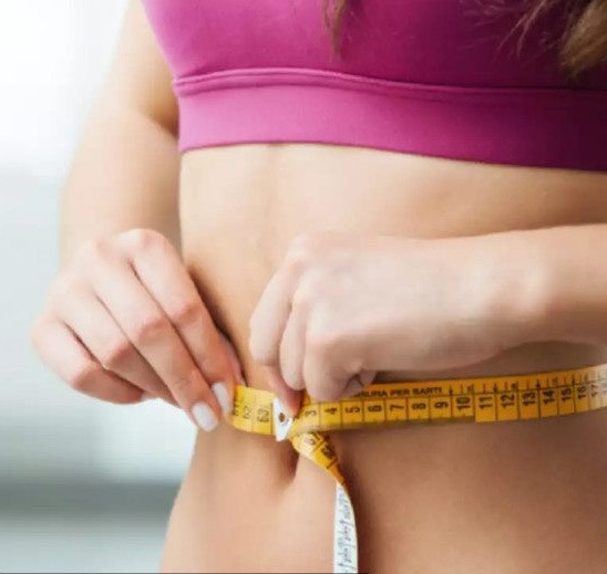 Healthy person checking their shape and size