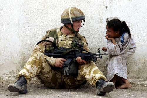 Soldier talking with a young child