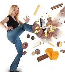 Woman kicking away unwanted junk food